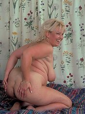 Pretty mature blonde with flabby tits and a huge ass bares it all to strut her goods for the camera