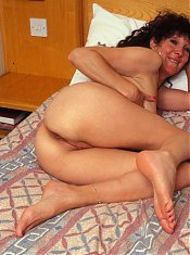 Horny mature slut showing her tasty body