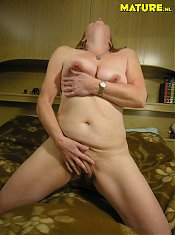 Mature slut showing her wet pussy
