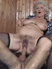 See nasty grandma Erin as she gets her nipples sucked and rides a hard young shaft live