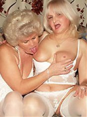 Sexy older babe Francesca goes down on Erlene and gives her pussy a good lapping